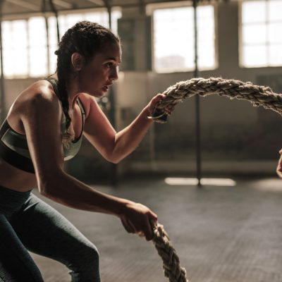 Strong,Woman,Exercising,With,Battle,Ropes,At,The,Gym,With